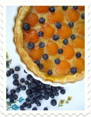 What You Need:  Pepperidge Farm puff pastry sheets, thawed  1 jar lemon curd  canned apricots (reserve liquid)  blueberries  1 jar strawberry ice cream topping  For the apricot-lemon curd tart, I thinned the lemon curd with apricot juice and spread it onto the pastry. After arranging the apricots (I added the blueberries *after* cooking), I popped the pan into a preheated 400 degree oven and cooked 20 minutes.  For the apricot-strawberry tart, I mixed lemon curd with the strawberry topping.