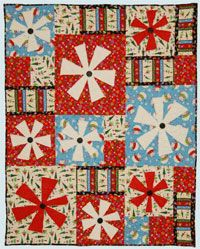 Tis the Season Christmas Quilt Pattern by Abbey Lane Quilts at KayeWood.com. Three Dimensional Snowflakes accent the great Christmas prints in the quick to make quilt. TIS THE SEASON uses large blocks which go together fast. The snowflakes are raw-edge appliqued and finished off with big buttons. http://www.kayewood.com/item/Tis_The_Season_Quilt_Pattern/3595 $9.50