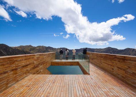 High-altitude viewpoint perches over a volcanic crater lake.