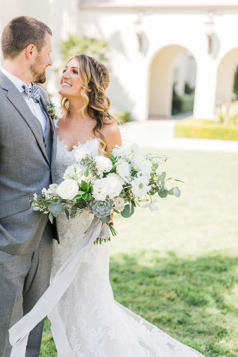 Gorgeous lush succulent bouquet for beach wedding at Scripps Seaside Forum Beautiful white and blue flower palette with succulents tucked in to a lush textured bridal bouquet for a beach wedding in La Jolla at Scripps Seaside Forum created by San Diego wedding florist Le Champagne Projects.