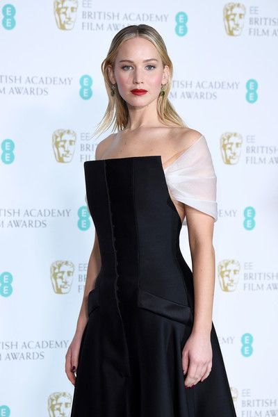 Actress Jennifer Lawrence poses in the press room during the EE British Academy Film Awards (BAFTA) held at Royal Albert Hall.