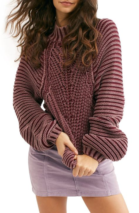 A chunky knit maximizes the cozy appeal of a timeless sweater with a ribbed mock neck and supremely slouchy silhouette.