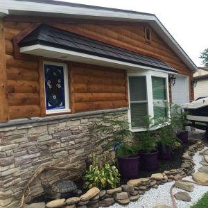 3x8 Hewn Cedar Half Log With 8x8x8 Cedar Vertical Corners And 4x4 D Trim Log Siding Cedar Log Stone Siding