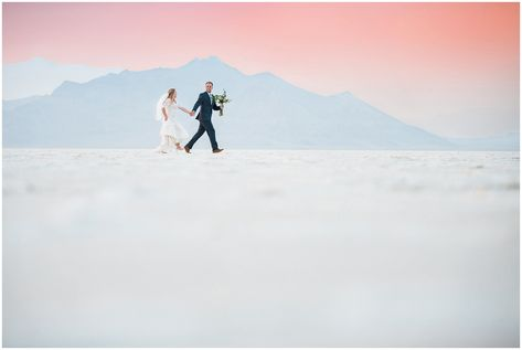 Bride and Groom at sunset in lace detail dress and blue suit for Adventure Session | Bonneville Salt Flats Sunset Wedding Formal Session | Jessie and Dallin Photography #utahwedding #utahweddings #utahweddingvenue #ldswedding #ldstemplewedding #utahbride #utahbrideandgroom #utahweddingvendors #summerwedding #ldsbride #saltflats #bonnevillesaltfalts #saltflatswedding #utahelopement #rockymountainbride #rockymountainwedding #saltflatselopement