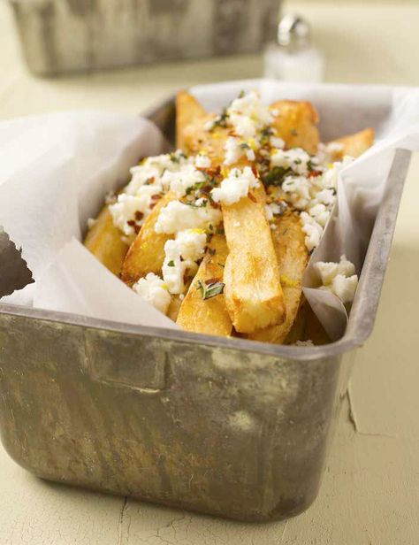 """Feta Fries, or """"Greek Fries,"""" are one of my favorite Greek Festival treats!  This recipe combines twice-fried potatoes (Makes 'em extra-crisp), Rosemary, Thyme, Marjoram, and a bit of Lemon and Red Pepper, all topped with Feta Cheese.  This recipe comes from Emeril Lagasse, and you know, everything he makes is GOOD.  ~~  Houston Foodlovers Book Club"""