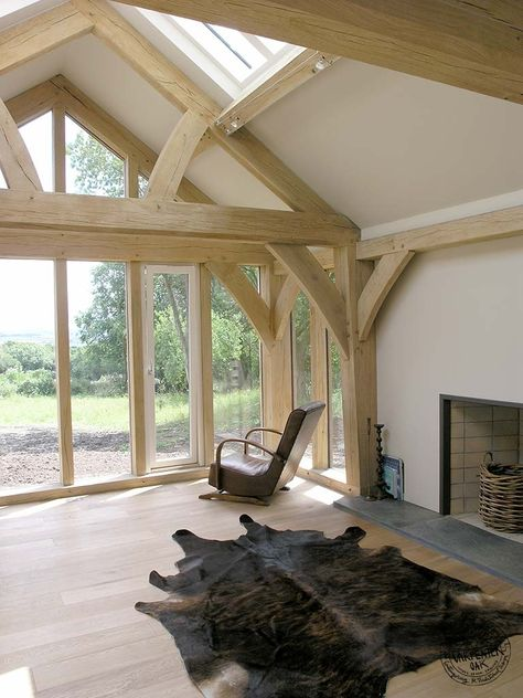 Living Room with Exposed Oak Queen Post Truss in New Build Oak Frame House in Cornwall by Carpenter Oak Ltd