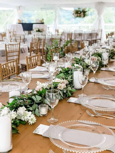 Farm Table Wedding Tablescape With Greenery In 2020 Farm Table Wedding Wedding Table Garland Table Runners Wedding