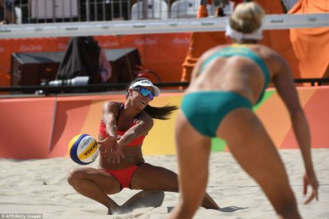 Costa Rica's Natalia Alfaro tries to control the ball during the women's beach volleyball encounter against Australia