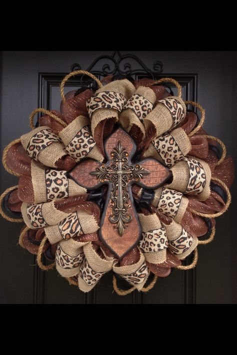 Deco mesh and burlap cross wreath, I don't love everything about it but I like the idea of deco with burlap.