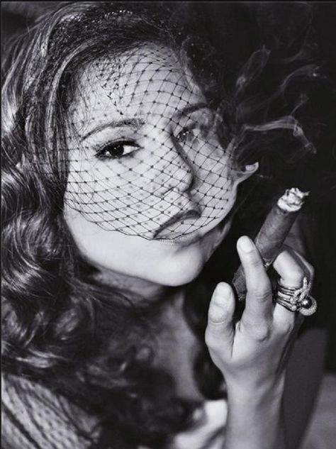 Cigar smoking babe