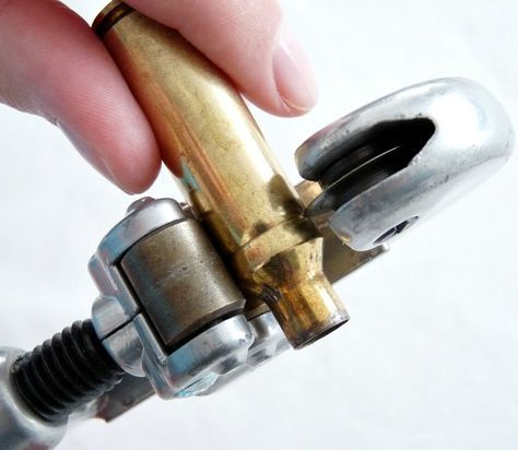 Using a pipe cutter to trim shell casing