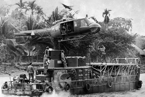 "A Huey helicopter prepares to land on a riverboat in the Mekong Delta. Walla Walla Valley native Ed Eaton was one of the members of the ""brown water navy,"" which patroled waterways in Vietnam and is described in his new book Mekong Mud Dogs."