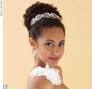 Natural Curls This structured yet whimsical updo is ideal for curly hair. Hair and Makeup by MG Hair and Makeup