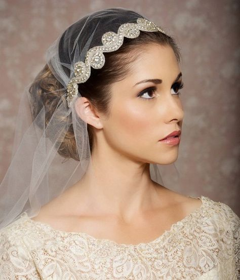 This delicate, Art Deco inspired veil is a modern take on the glamorous era where the Juliet Cap Veil became a wedding trend. It is made of soft, high quality tulle in several color options. A gorgeous band of clear rhinestones with silver-tone settings and glass beads in a lovely swirled Art Deco