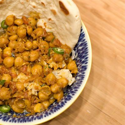 My favorite Indian dish and the Chana is vegan: Chana masala and garlic naan.  This was my go to meal during grad school :)