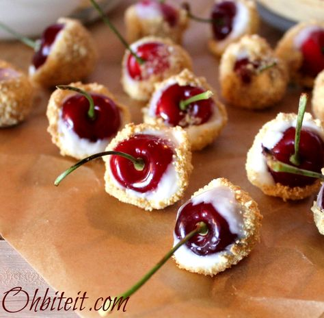Cherry Cheesecake Bites!!  Plump and sweet Cherries, coated in rich and thick cheesecake-ish heaven..and then dusted with Graham Cracker crumbs!!