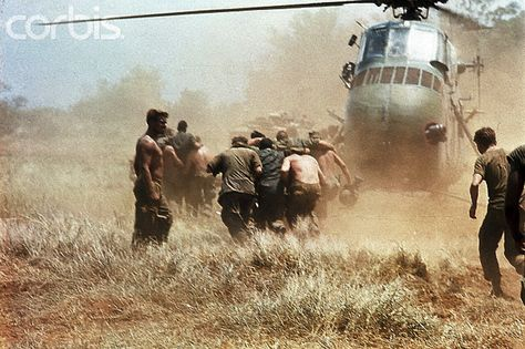 25 Sep 1967, Con Thien, South Vietnam --Marines rush wounded to helicopter for evacuation. | by tommy japan