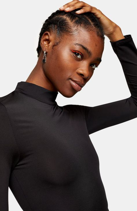 This shapely mock-neck bodysuit is ideal for layering, lounging or hitting the town.