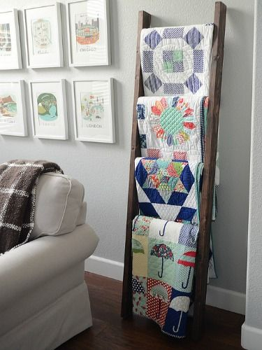 How to Decorate With Vintage Ladders -  Quilt rack, this is a neat way to display your quilts or afghans.