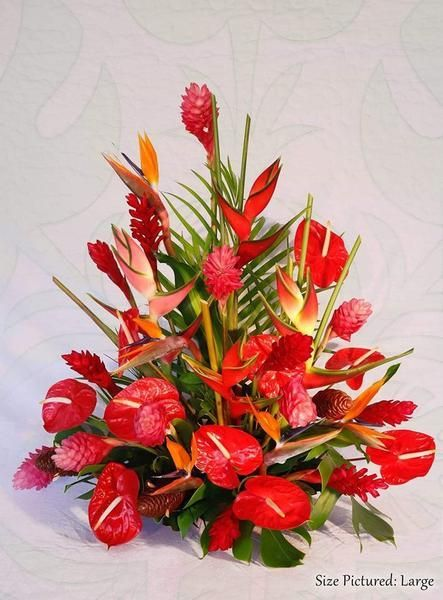 This Stunning Tropical Arrangement Is Enough To Brighten Anyone S Day So It S The Perfect Fl Tropical Flower Arrangements Blue Flowers Garden Tropical Flowers