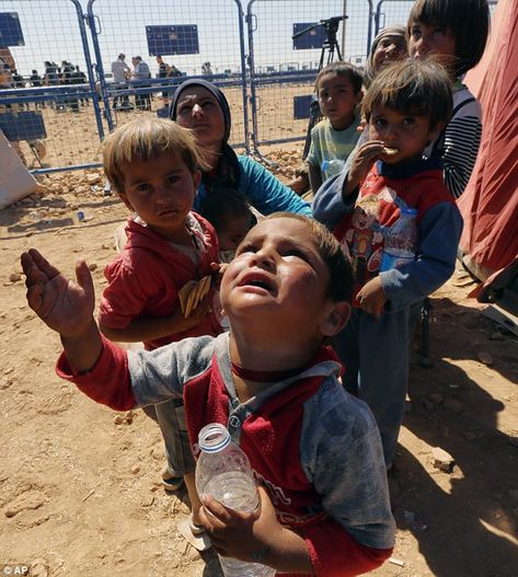 Young Syrian refugees stand in dusty ground in Turkey after fleeing terrorist group Isis #narenjtree