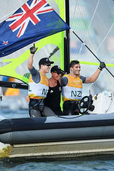 Peter Burling of New Zealand and Blair Tuke of New Zealand celebrate with team…
