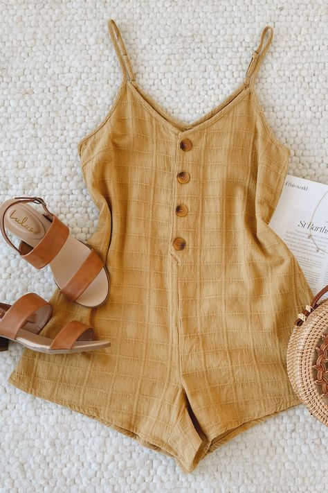 Your official summer outfit is here! Lulus Amalie Dark Mustard Button-Front Sleeveless Romper is the perfect summer staple for days in the sun. The loose casual fit has a plaid pattern that runs throughout the cotton body and breezy shorts. Style with tan sandals and a woven bag for your summer plans. #lovelulus