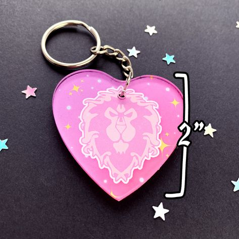 """""""------- ☆ DESCRIPTION ☆ ------- Heart-shaped, acrylic keyring to show off your faction pride. 🖤 All items are designed & handmade here in our little home studio with great appreciation and care. We love WoW as much as you do. 🖤 ------- ☆ DIMENSIONS & INFO ☆ ------- ⚡ Approximately 2\"""" x 2\"""" ⚡ Single side design - back is white ⚡ Comes with 2\"""" chain with jumpring fitting ⚡ Acrylic charm Please note - the colours of the physical keyring may vary slightly to the colour portrayed on your"""