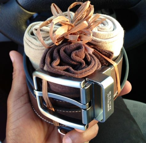 """Manly Gift: I did this for my father in law""""s birthday. I didn't want to just give him his socks and belt without making it presentable. I also did not want to wrap it in a box as he is a manly man and would have accepted the gift graciously but also given me a little smirk. Great way to man up a gift with simple twine."""