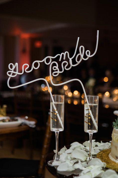 Personalized straws for the bride and groom's champagne glassses | Photographer: Priscilla de Castro