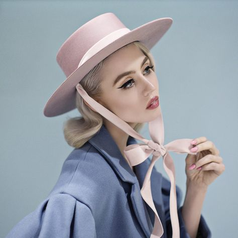 100% wool felt bolero hat in blush with luxurious velvet ribbon ends, which can be tied in the front or back. Handcrafted in the United States.