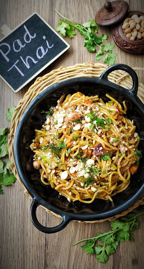 Pad Thai is a noodle dish from Thailand, bursting with flavours. Sweet and sour and spicy all at once, it is quite a treat to the tastebuds. It's not very difficult to whip up a bowl of delicious Pad Thai at home, from scratch. Check out my recipe! #padthai #padthainoodles #vegetarianpadthai #thainoodles #vegetarianthainoodles #thaifood #thaicuisine #asiancuisine #asianfood #asiannoodles #vegetarian #easynoodlesrecipe