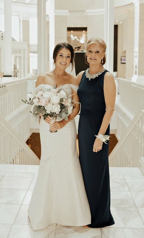 of the bride in navy gown with jewel encrusted neckline standing beside bride Source by of the bride in navy gown with jewel encrusted neckline standing beside bride Source by Sleeves Sexy Elegant Mother of The Bride Dress Evening Party Prom Dress Mother Of The Bride Dresses Long, Mother Of Bride Outfits, Mothers Dresses, Gown For Mother Of The Bride, Mother Of The Groom Hair, Mother Of The Bride Inspiration, Long Mothers Dress, Navy Gown, Mom Dress