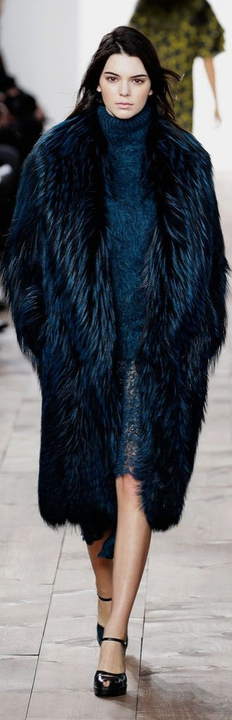 Kendall walked the runway in a true-blue look at Michael Kors.