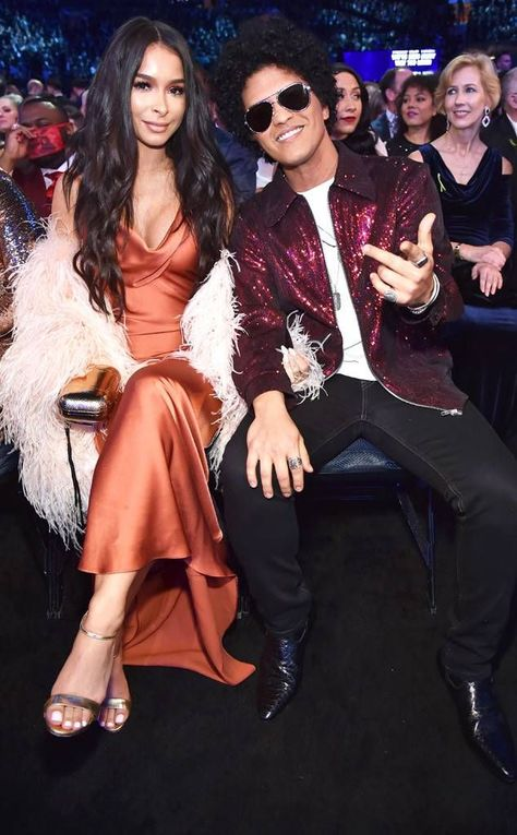 Jessica Caban & Bruno Mars from Grammys Candid Moments The model supports her man on Music's Biggest Night.