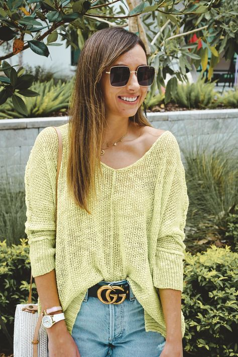 Lime green sweater, Agolde denim shorts, Gucci belt, white rattan bag, square sunglasses #casualoutfit #summerstyle #summeroutfit