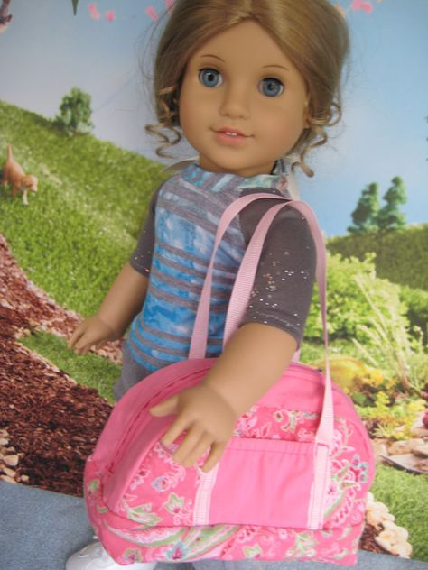 """Sport bag for an 18"""" doll, with zippered top opening, grosgrain straps, and two outside pockets."""