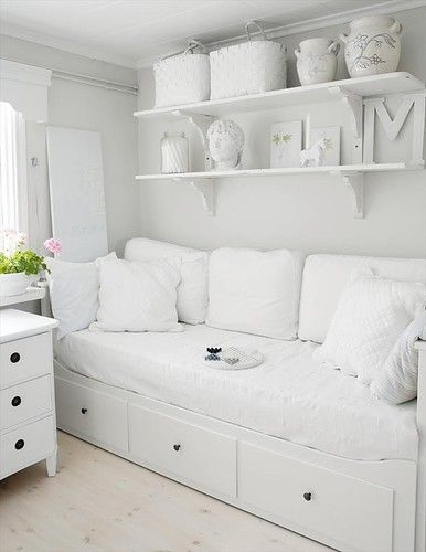 all white day-bed with shelving for a small bedroom.