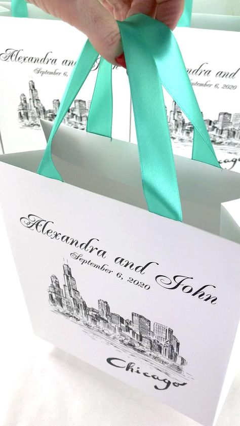 Chicago wedding welcome bags with mint satin ribbon handles and custom names. Elegant personalized destination wedding favors for guests #partyfavors #welcomebags #favorbags #giftbags #favorideas #favors #weddingfavors #weddingparty #weddingwelcomebags #weddingfavour #ivorywedding #weddingthankyou #weddingwelcome #weddingwelcomebags #weddinggoodiebags #mintwedding #destinationwedding #chicago #chicagowedding