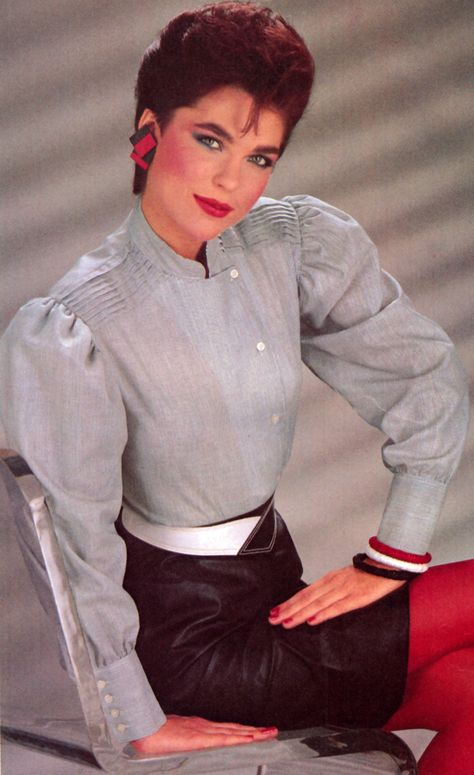blouse with shoulder pads, offset buttons, pleats