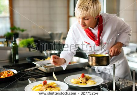 Female Chef In A Restaurant Or Hotel Kitchen Cooking Delicious