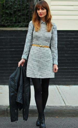 Fall outfit: check knit under a grey dress + mustard belt + black opaques + ankle boots + leather biker