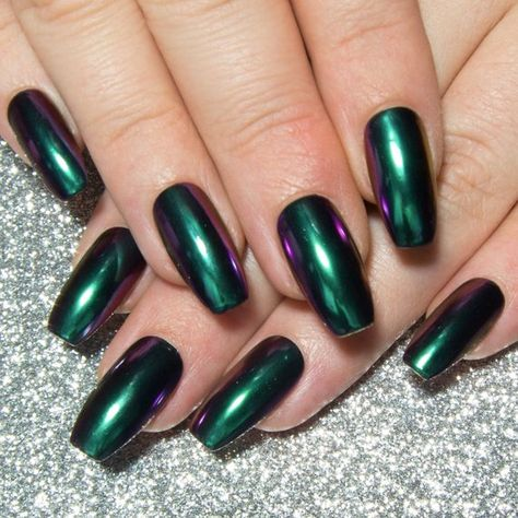 Perfectly capturing the mesmerising beauty of a jewel beetle, these green chrome nails will shift through hues of blue and purple with even the tiniest of hand movements, making this a manicure that you wont be able to take your eyes off of.  Coated with two layers of gel top coat for extra
