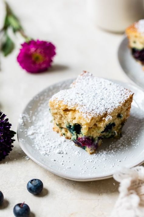 This light and Easy Blueberry Buttermilk Cake loaded with fresh, juicy blueberries in a lightly sweetened, moist buttermilk cake is ideal for summer. #blueberrycake #cake #blueberrydesserts
