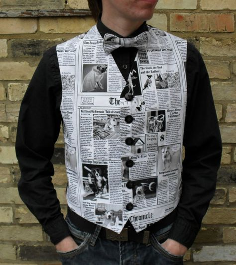 Catch up all the latest doggy gossip with this black and white newspaper print waistcoat. Made with printed cotton on the front and black taffeta lining on the back.