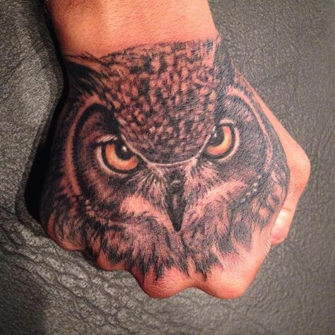 Owl tattoo on guys hand