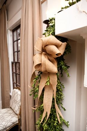 Burlap bow and greens... Perfect for den mantle.  Burlap is great to use for Christmas decorations.