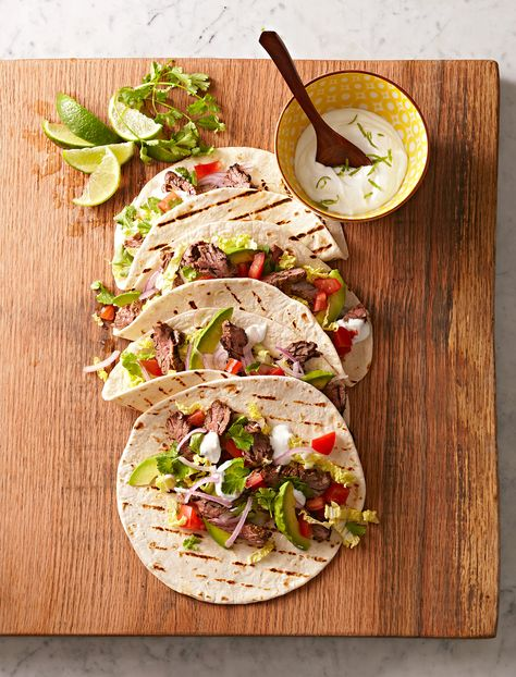 Ground beef is good, but marinated grilled steak is even better. One bite will have you convinced: These aren't your ordinary tacos. #mexicanfoodrecipes #easy #best #bhg