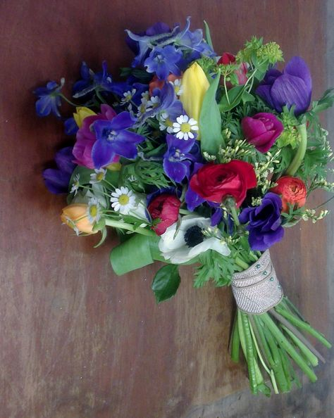 Ranunculus, tulips, delphiniums  and anemones by Peamore Flora