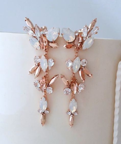 #weddings #jewelry #earrings #swarovskiearrings #swarovskiearcuff #climbingearring #statementearring #bridalearring #crawlerearring #climbingearrings #blushearrings #bridalearrings #whiteopalearrings #rosegoldearrings #chandelierearrings